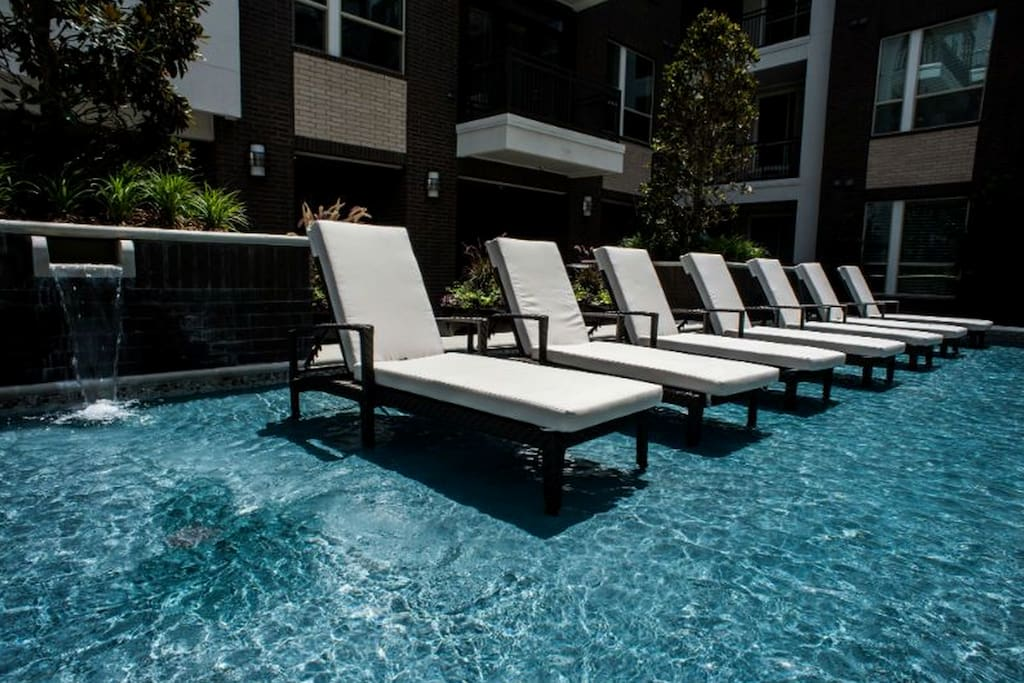 Relaxing pool area with grills and lots of outdoor seating