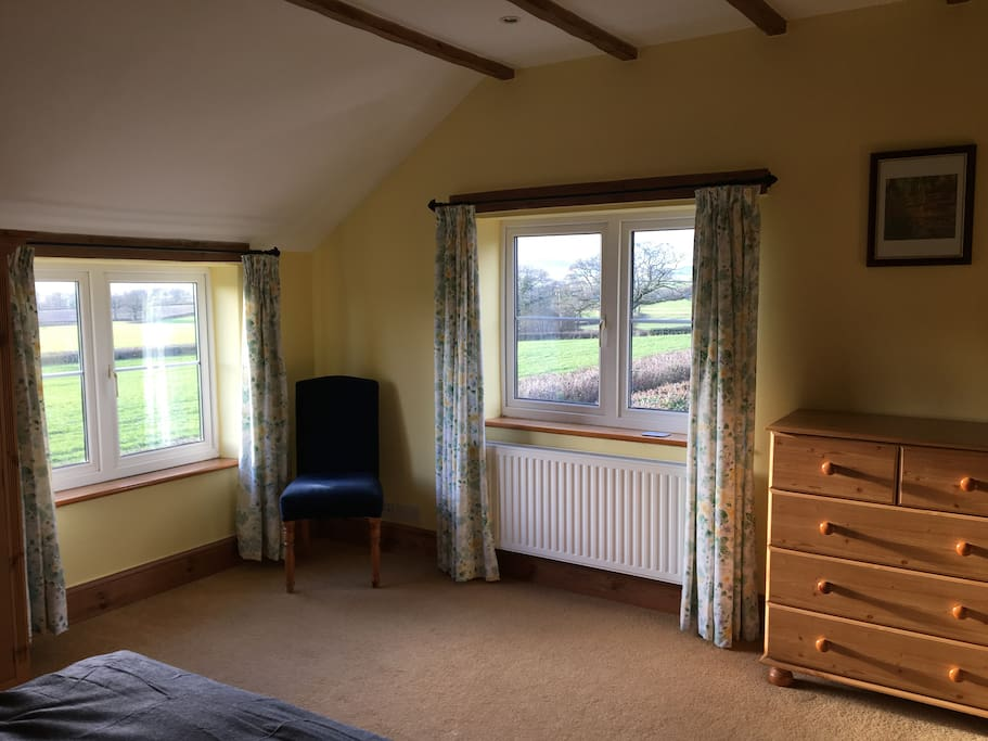 The bedroom has beautiful, far reaching views across the Marshwood Vale towards the coast and the setting sun.
