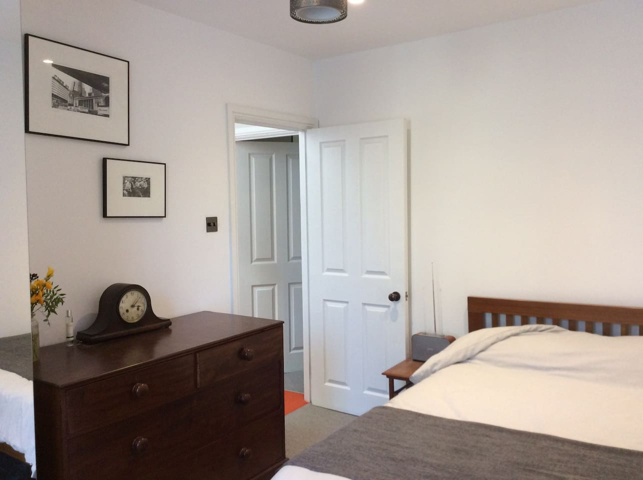 Comfy double bed with crisp cotton sheets, large chest of drawers, side table, digital radio and double mirrored wardrobe.