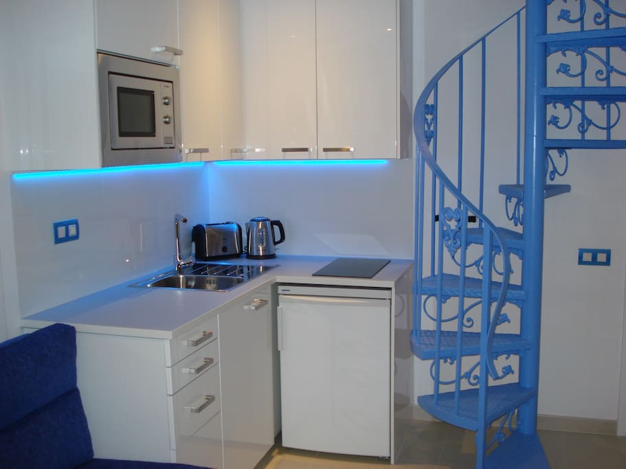 Kitchen and feature spiral staircase