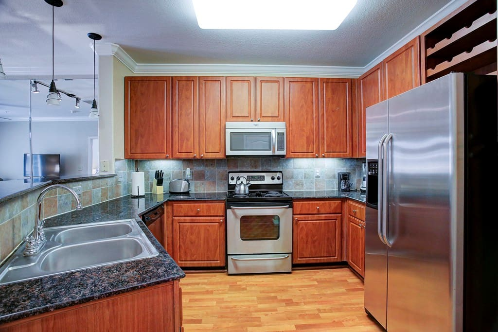 Kitchen is open to living and dining.