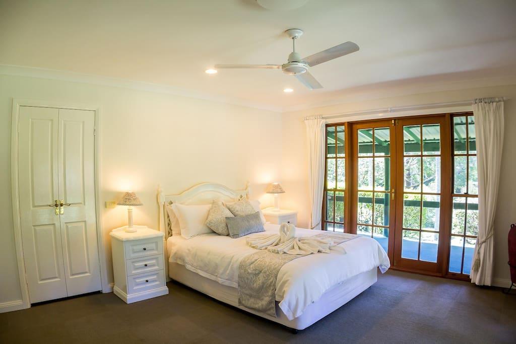 Main ensuite bedroom opening onto the wrap around veranda