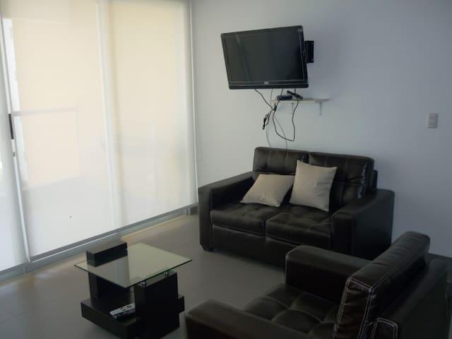 Sala de televisión con DirecTV