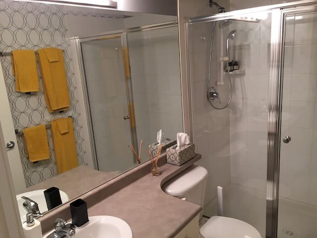 Your private bathroom just down the hall from the bedroom with a large and luxurious shower