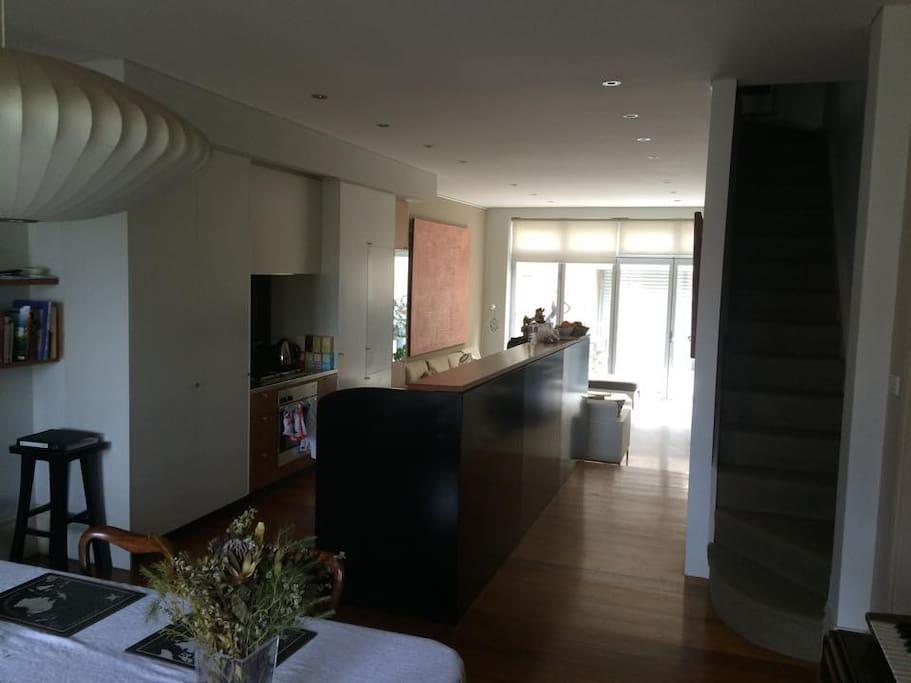 Dining room/ kitchen/ living room/ garden.