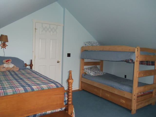 Second bedroom with full bed, bunk beds and single bed