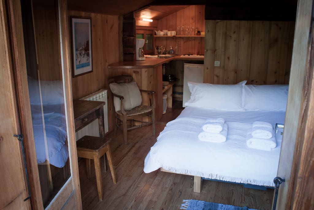 a comfortable and warm bed, a kitchenette and...