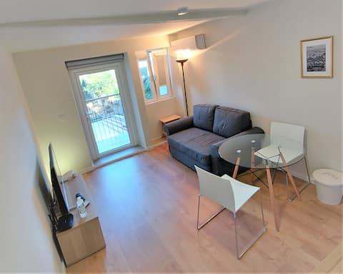 Centre historique balcon famille confortable appartement AC Wifi