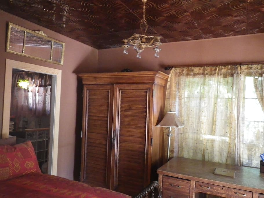 Bedroom with double bed, writing desk, copper ceilings. Sleep in! Or walk out onto the covered deck