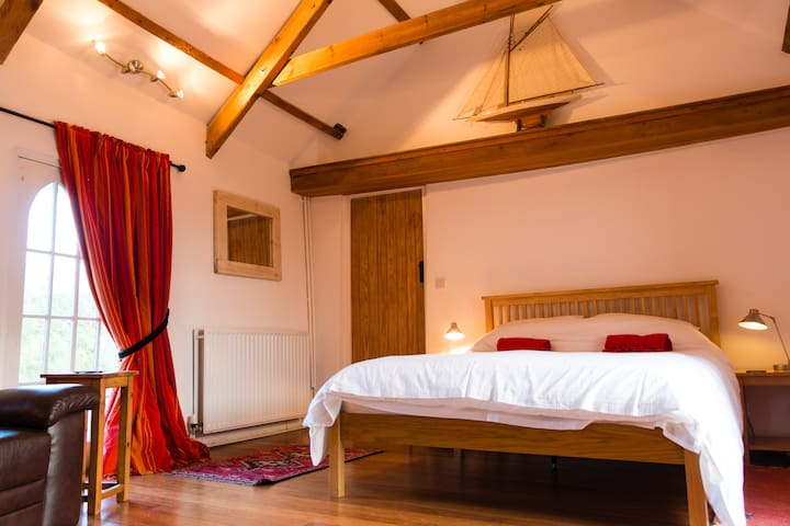Sleep luxuriously under the beams of this Old Dairy.