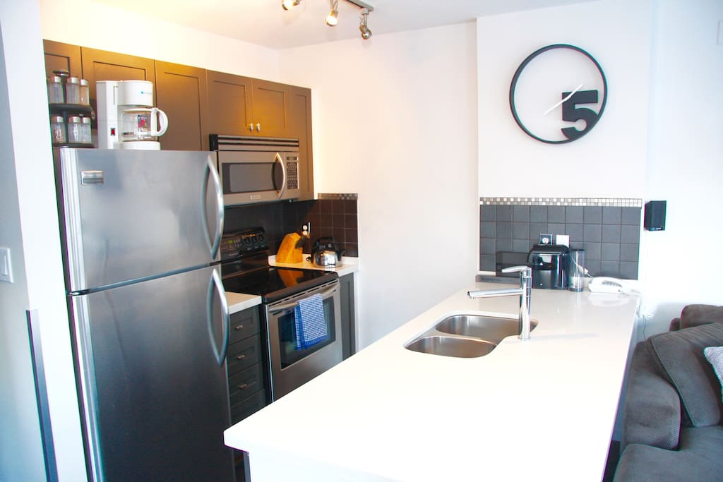 Updated kitchen with stainless steel appliances is equipped with the tools most anyone would need when preparing your meals!