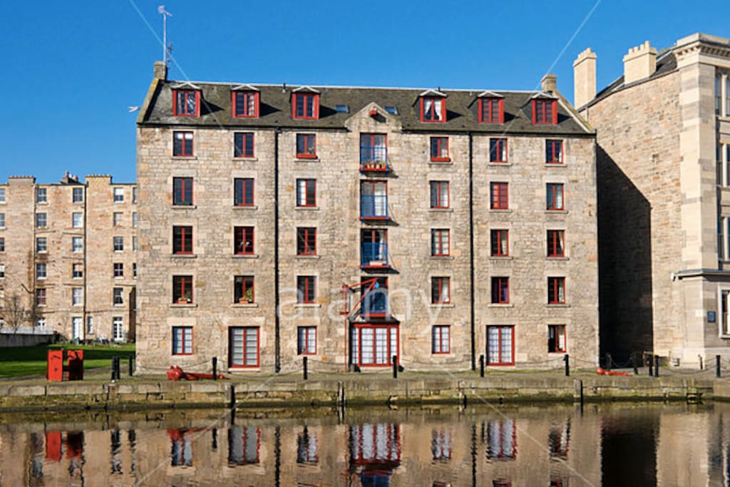 Late 18th century converted whisky cooperage. The apartment looks out of the other side of the building.