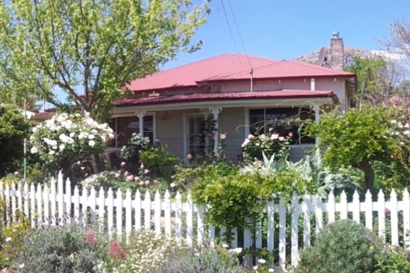 Our home is framed by a lovely cottage garden with a veranda to enjoy peaceful moments  and a wine at the end of the day.