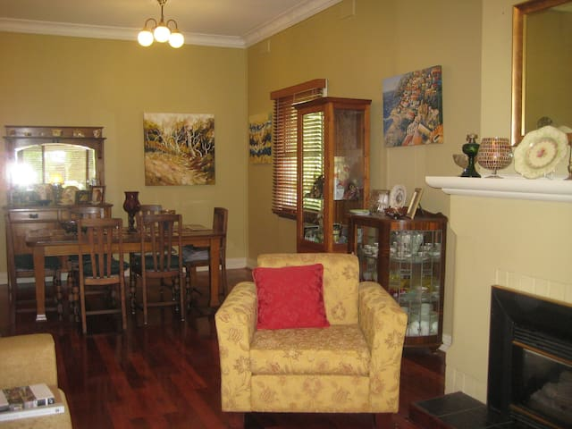 Our lounge room overlooking the dining room.  Has beautifully estapolled timber floors and comfortable furniture.