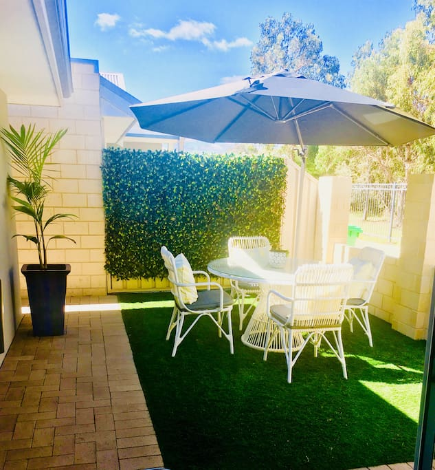 Side courtyard - great for enjoying your breakfast, morning coffee, reading a great book or enjoying the sun! Umbrella for shade, louvres and a gate to come!  Direct access to dining/lounge area from side courtyard.