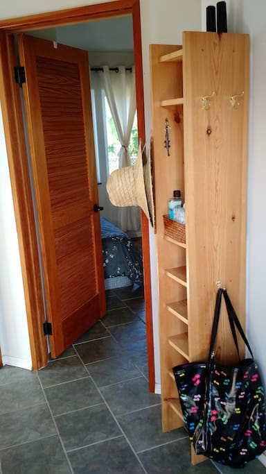 Inside the doorway is a place for your things.