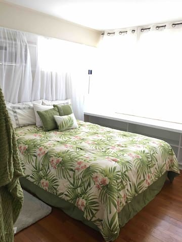 Great value, ocean view home, AC, WiFi, parking