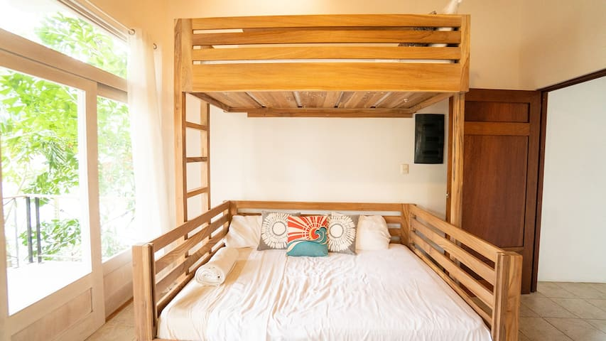 The 2nd bedroom has a queen sized mattress and a twin bunk overhead.