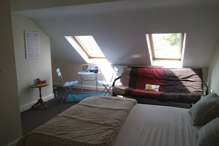 Bright and airy attic room with ensuite near town.