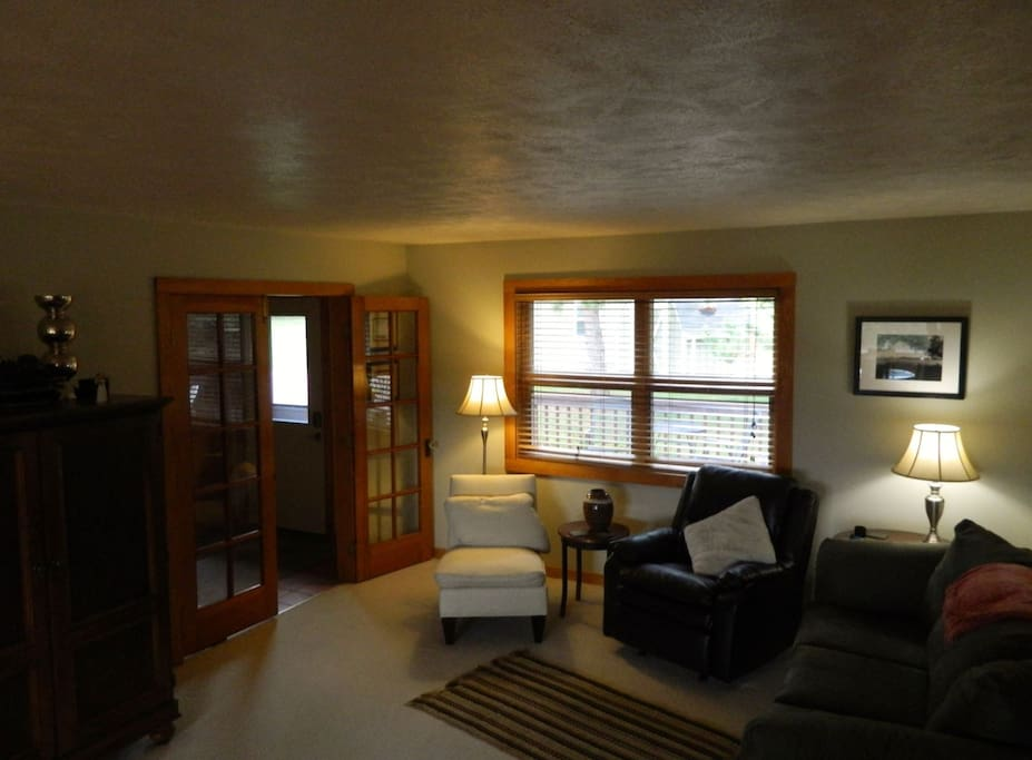 Upon entering the foyer, the cozy living room area is to your left which features a wood-burning stove.