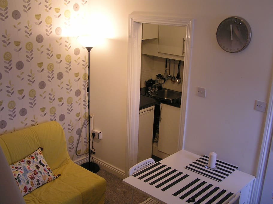 Living room showing kitchenette off it.
