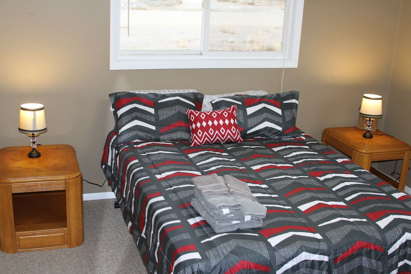 Queen sized bed in quiet corner of country home complete with two windows, fan, Wi Fi and closet.