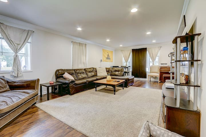 """""""The theatre room"""" aka huge family lounge area with 65in 4k TV, surround sound speaker system and black out curtains all around."""