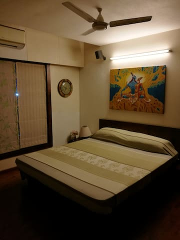 Modern master bedroom located near Airport.