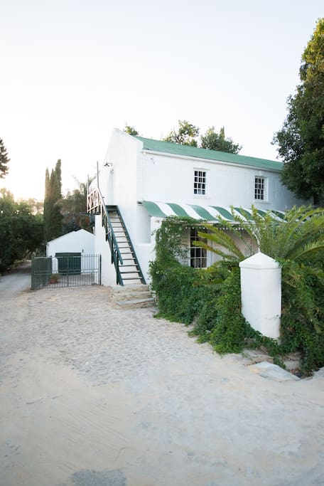 The side of the house shows the entrance to the honeymoon loft and the coach house cottage