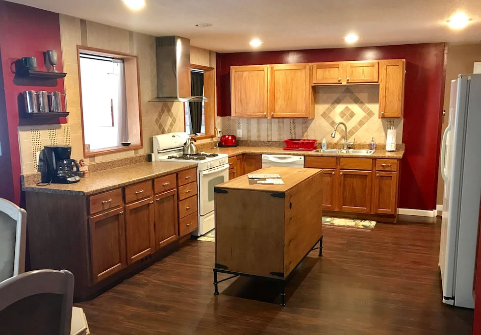 Large kitchen with flatware, utensils, gadgets and even some coffee to get you started
