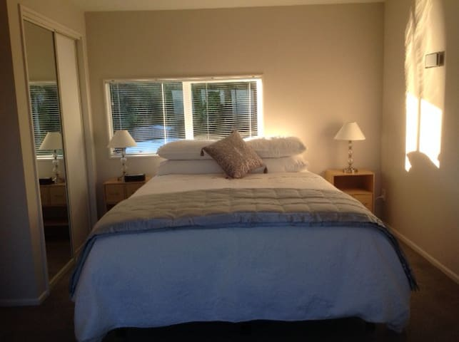 The bedroom has a new queen-size bed, quality linens and a panoramic view.