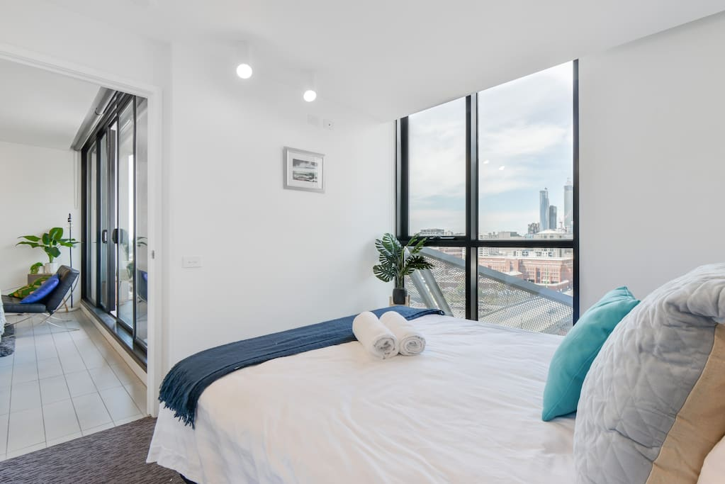 Enjoy the city view with full length glass windows