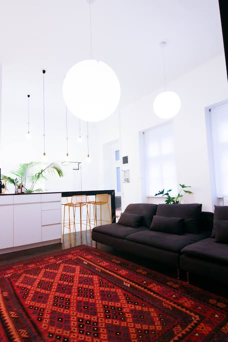 """A spacious living area with large 47"""" TV accompanied with a cable TV with more than 30 international channels for your lazy stay-in days off from the city. Needless to say, an essential fast WIFI connection, a small but quaint work desk for in between vacation work for the digital nomad, or postcard writing to echo to your loved ones back home."""