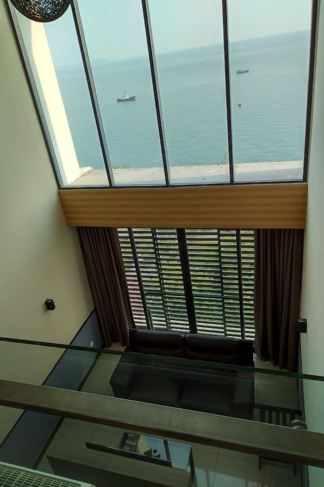 Double volume seafronting living Space, offering magnificient views!