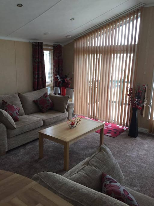 Open space lounge with two sofas, TV, freeview