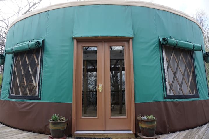 """The yurt is situated to capture the breezes. Open the windows to experience the mountain zephyrs. To keep cooler during the summer follow the sun and close the outer covers to block the heat. The French door opens to 48""""."""