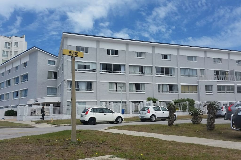 The self-catering apartment is in this 3 storey building which is freshly painted and a across Pollock Beach.