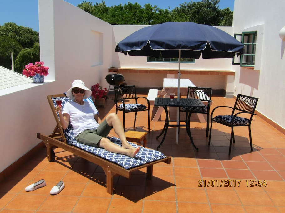 Sunny, spacious sun patio and barbecue facility.  Ideal for that perfect tan or sun downer.
