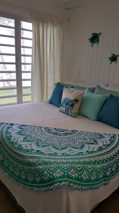 Master king bedroom opens to the backyard so you can feel the breezes and listen to the waves