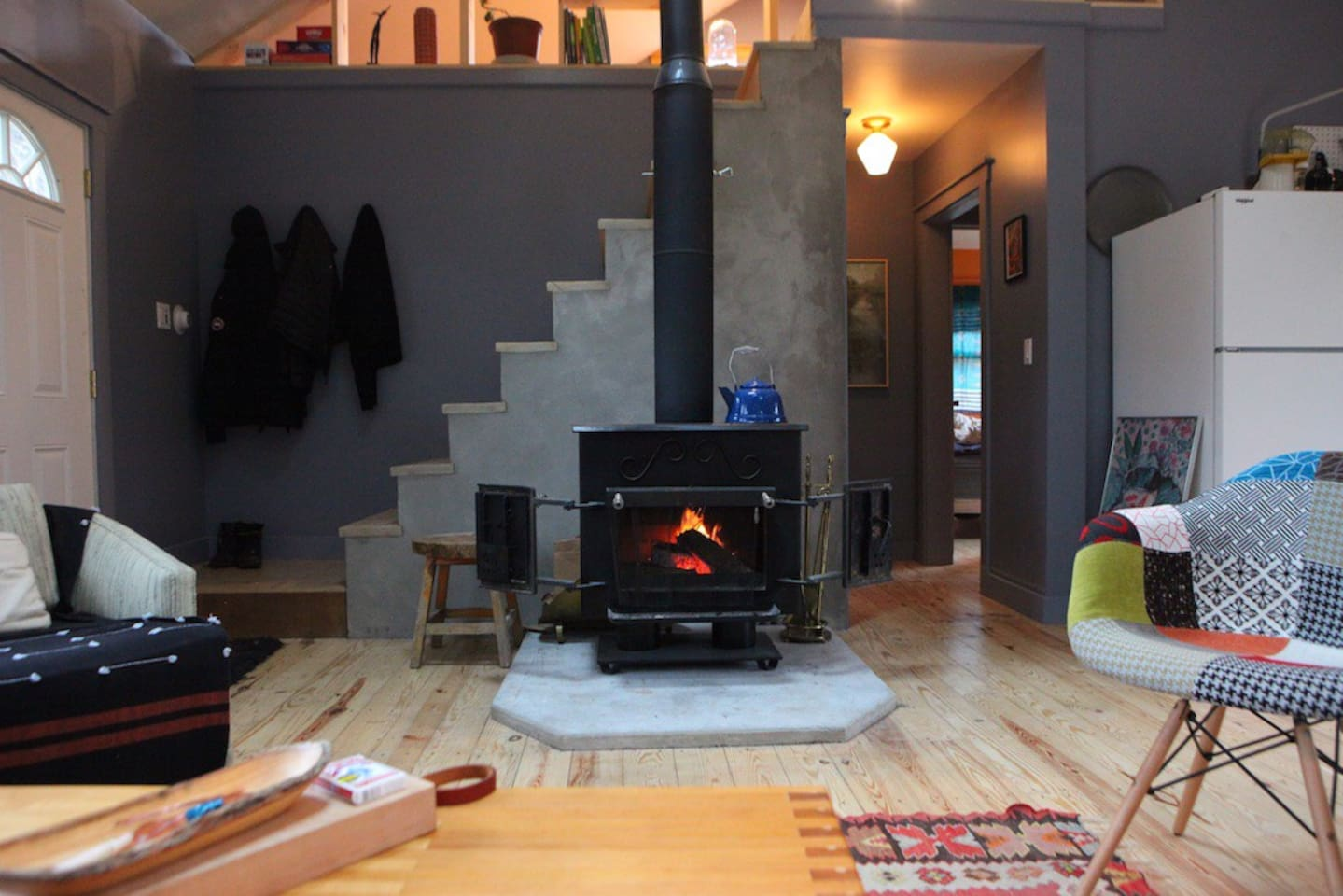 wood stove adds cozy ambiance and makes the house toasty during winter months
