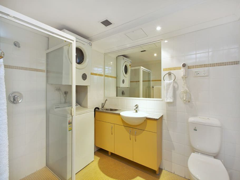 Modern bathroom with internal laundry, washing machine & dryer