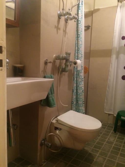 """Bathroom with a """"rainforest"""" shower and hot water"""