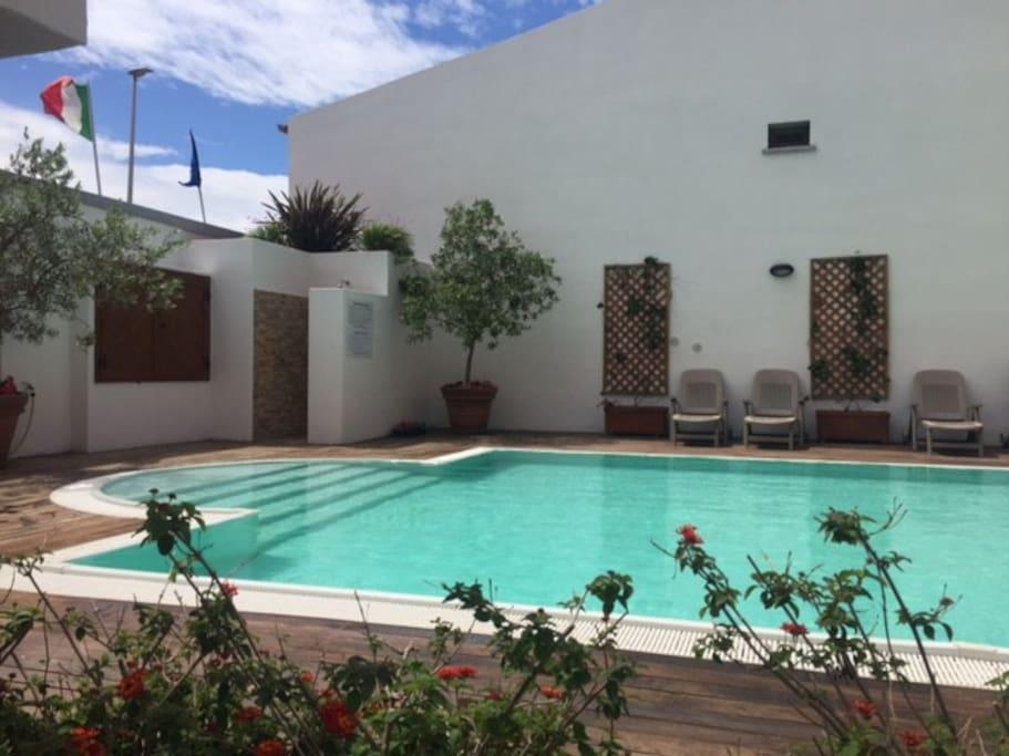 Bellissimo bilocale con piscina apartments for rent in for Piscina santa teresa