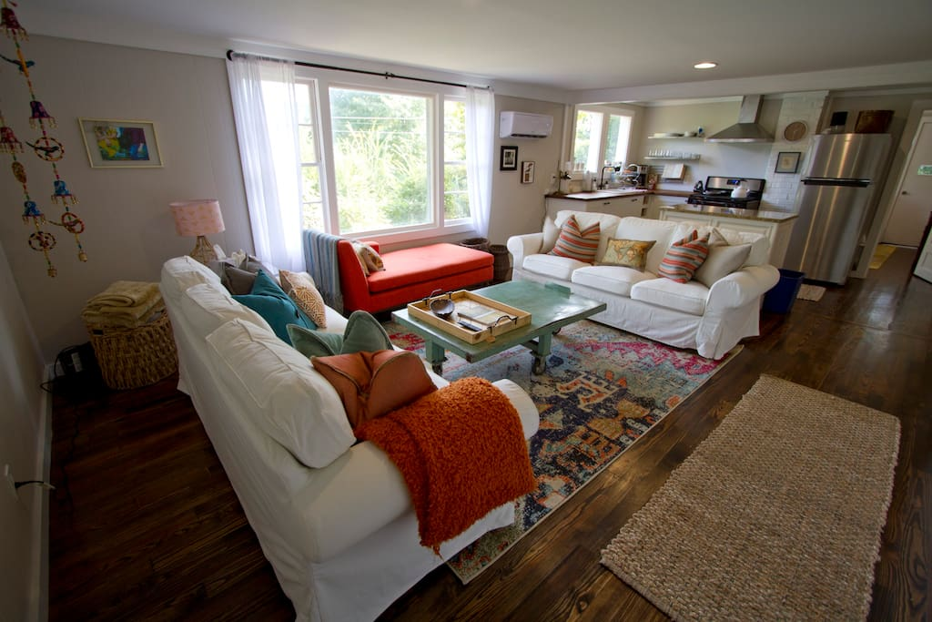 Bright and happy living room with plenty of seating.