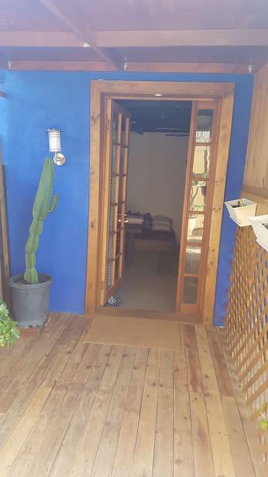 Front door off the patio and back garden