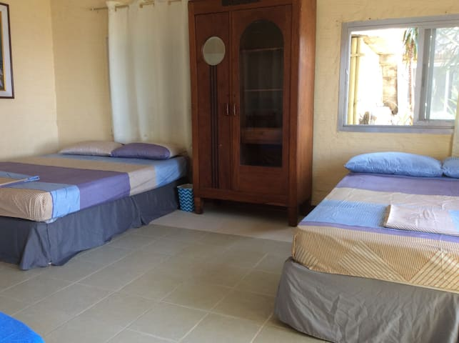 Big beds, AC, private bathroom with shower