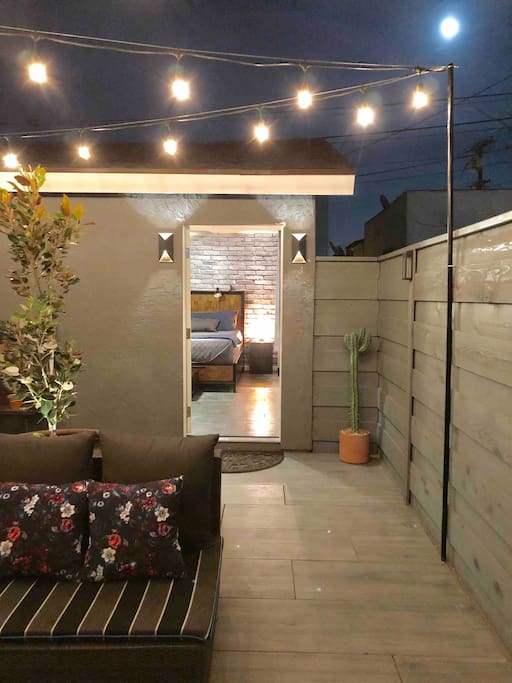 Private patio space with lounge furniture and overhead bistro lights... perfect for those beautiful San Diego nights.