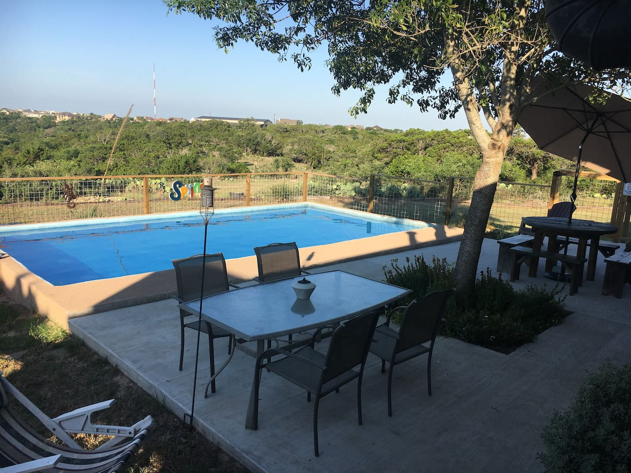 Pool with view of Kerrville on 18 acres! We also have a hot tub, with outdoor shower to rinse off first