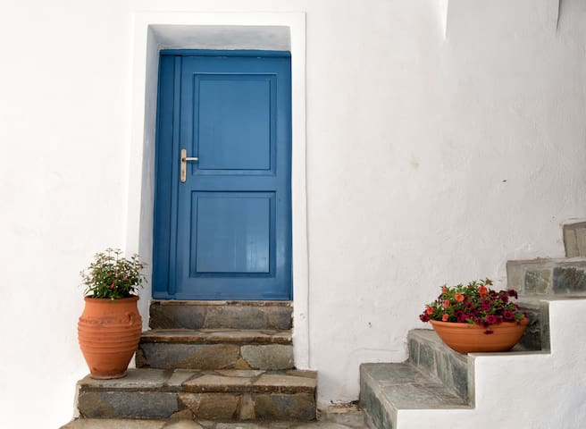 This is the traditional entrance to the Nest. Your vacations in our island start here. Please open it and find  out what lies inside.