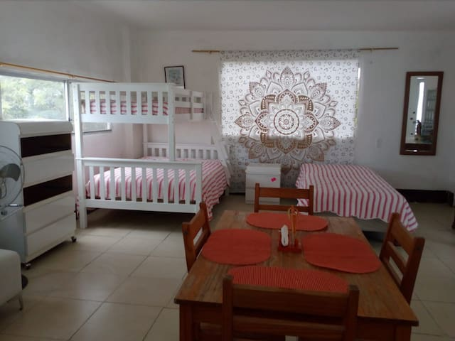 Suite #3  3 beds Full kitchen  1 bathroom  Ac and warm water Dining room area  Balcony and beach view